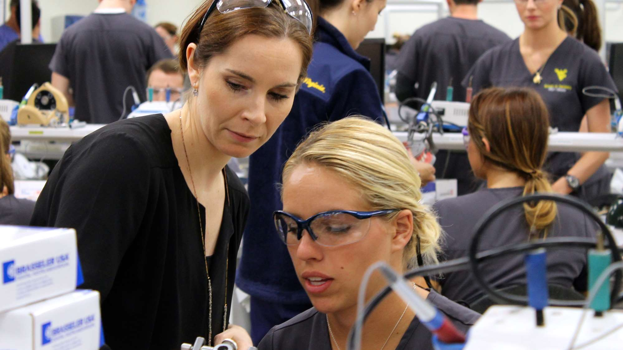 A WVU dental school student receives one-on-one instruction in a small class size.