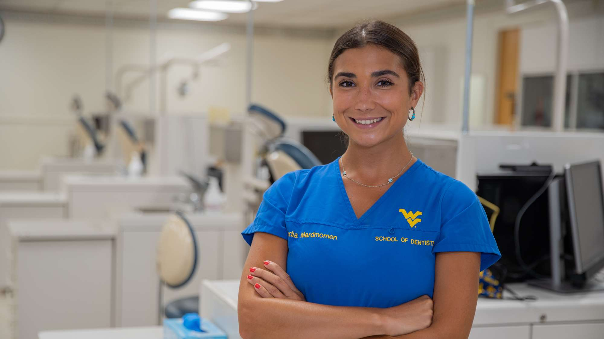 Nadia Mardmomen smiles in clinic as she talks about her path through dental school.